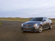 black sedan / Cadillac