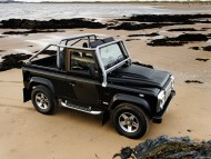black jeep on beach / Land Rover