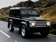 Defender black jeep on highway / Land Rover