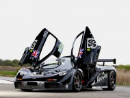 black front doors opens up / McLaren