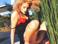 nice under skirt / Elizabeth Berkley