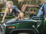 Smoking women on hood green Hummer / Girls & Cars