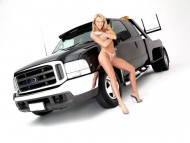 black Ford pickup / Girls & Cars