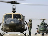 One Iraqi UH-1H Iroquois Huey & One Iraqi Mi-17 Hip helicopter / Helicopter