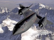 Stealth aircraft above mountains / Military Airplanes