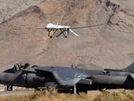 AV-8B Harrier waits as a MQ-1 Predator lands / Military Airplanes
